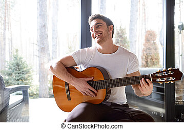smiling man with guitar - Portrait of handsome man with...