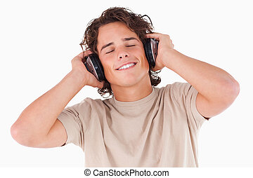 Smiling man with headphones having eyes closed
