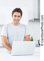 Smiling man with laptop