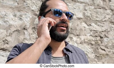 smiling man with smartphone calling on city street 7