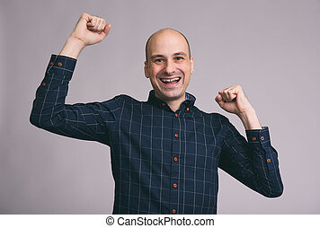 smiling man with the fists up - Portrait of smiling man with...