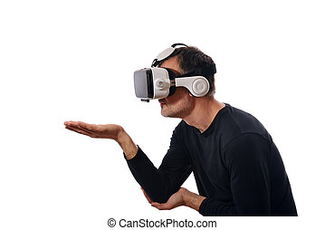 Smiling man wearing black pullover and virtual reality glasses interacting with hand outstretched in lateral position. Horizontal composition. Isolated white