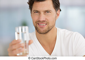 smiling man with water in a glass