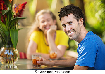 Smiling Man with Woman Outdoors