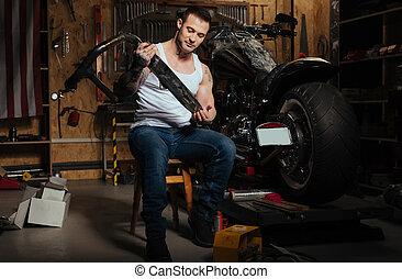 Smiling man working in the garage
