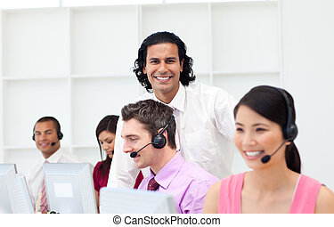 Smiling manager checking his employee\'s work