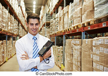 manager in warehouse - smiling manager in warehouse with bar...