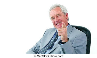 Smiling manager making the ok sign against a white background