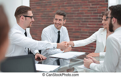smiling Manager shaking hands with customer
