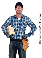Smiling manual worker with wood