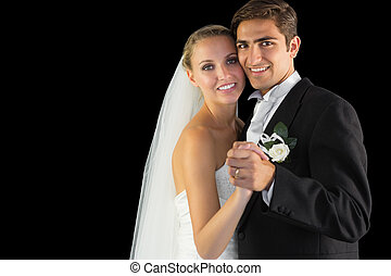 Smiling married couple dancing Viennese waltz smiling at...