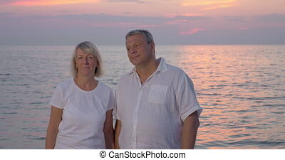 Smiling mature couple looking to the camera