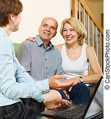 Smiling mature couple questionnaire for agent or employee