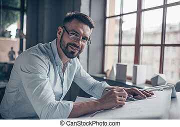 Smiling mature man at work
