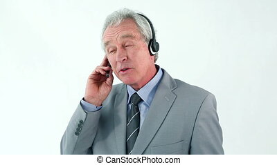 Smiling mature man using a headset