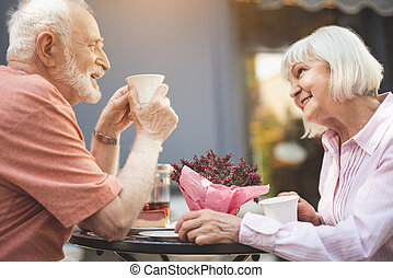 Smiling mature woman and man spending time outside