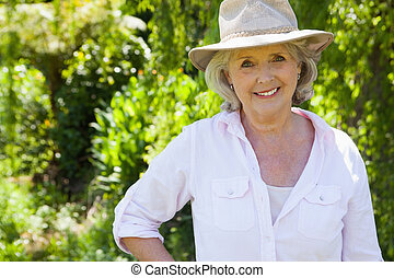Smiling mature woman at the park