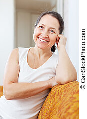 smiling mature woman in home