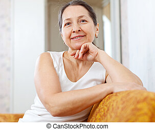 mature woman in home interior