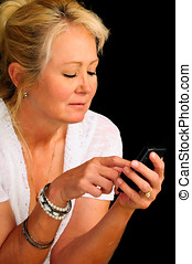 Smiling mature woman texting