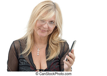 Smiling mature woman using smartphone