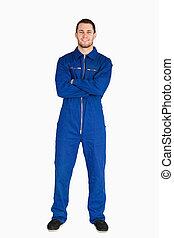 Smiling mechanic in boiler suit