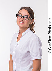 Smiling medical doctor woman over white background