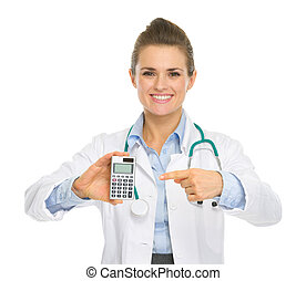 Smiling medical doctor woman pointing calculator