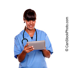 Smiling medical doctor woman using her tablet pc