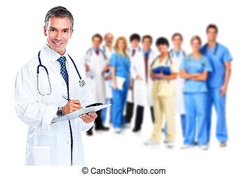 Smiling medical doctor writing a prescription.