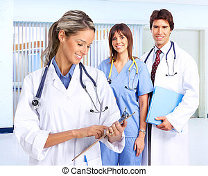 Smiling medical people with stethoscopes. Doctors and nurses...