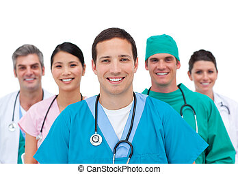 Smiling medical team against a white background