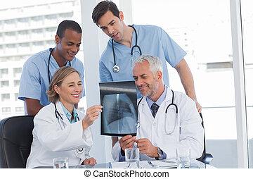 Smiling medical team examining