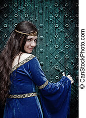 girl opening terrible door - smiling medieval girl opening...
