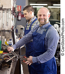Smiling men in coveralls working - Portrait happy male...