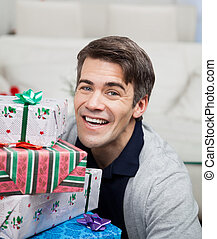 Smiling Mid Adult Man With Christmas Gifts