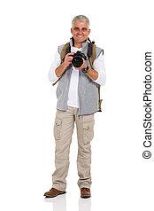 Middle age senior tourist male digital camera. Middle age senior ... 379676663236