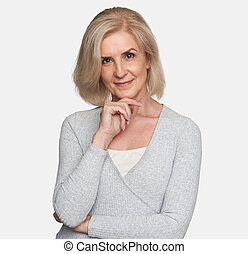 Smiling middle aged woman looking at camera