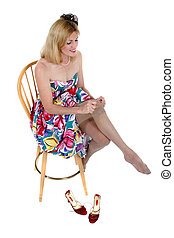Smiling Middle Aged Woman Putting On Her Hose 1