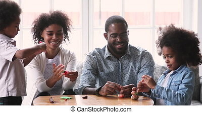 Smiling mixed race family engaged in diy activity. - Happy ...