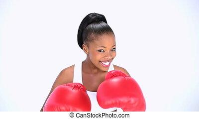 Smiling model boxing