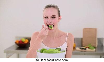 Smiling model eating a big bowl