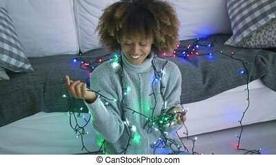 Smiling model with Christmas lights
