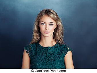 Smiling model woman on blue background. Young woman face