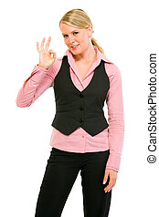 Smiling modern business woman showing ok gesture isolated on white
