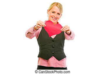 Smiling modern business woman showing Valentine paper heart