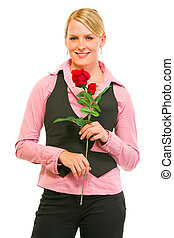 Smiling modern business woman with red roses in hand