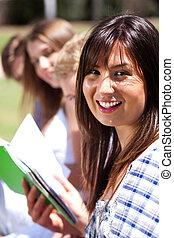 Smiling modern female student in focus
