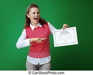 smiling modern student pointing at Certificate of Graduation