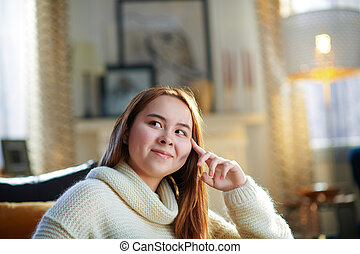 smiling modern teen girl and looking up on copy space